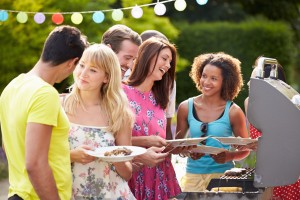 Group Of Friends Having Outdoor Summer Cookout At Home
